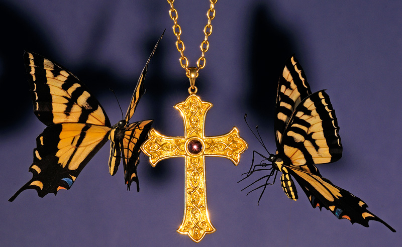 Tiger Swallowtail butterfly replicas and a gold Bishops cross